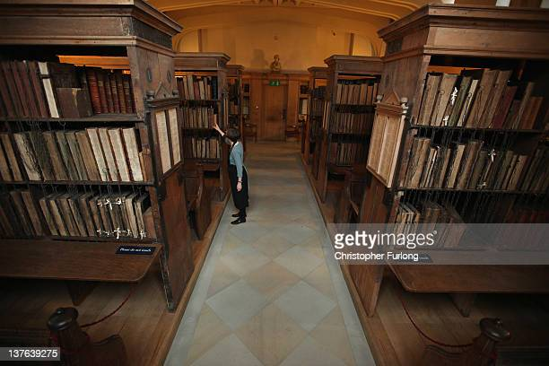 Dr Rosemary Firman librarian of Hereford Cathedral finishes cleaning historic manuscripts and books in the cathedral's Chained Library after it's...