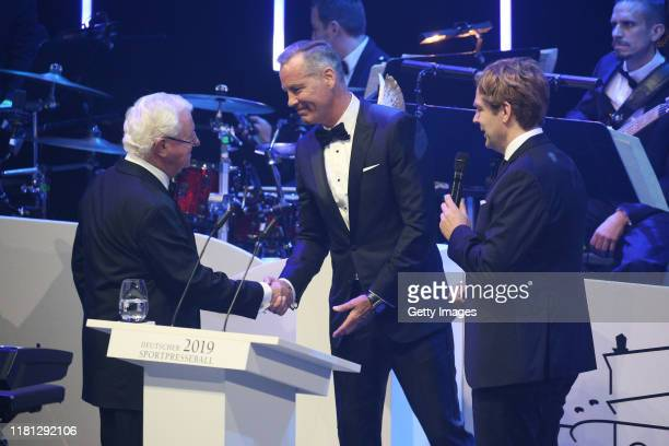 Dr Rudolf Seiters former Minister Henry Maske and Sven Hannawald with Pegasos award during the German Sports Media Ball at Alte Oper on November 9...