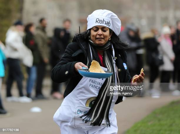 Dr Rupa Huq MP competes in the 21st Parliamentary Pancake Race on Shrove Tuesday, also known as Pancake Day or Fat Tuesday, in Victoria Tower Gardens...