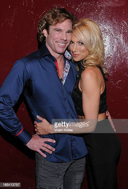 Dr Rutledge Taylor and Debbie Gibson attend iiJin's Fall/Winter 2013 The Love Revolution Clothing And Footwear Collection Fashion Show at Avalon on...