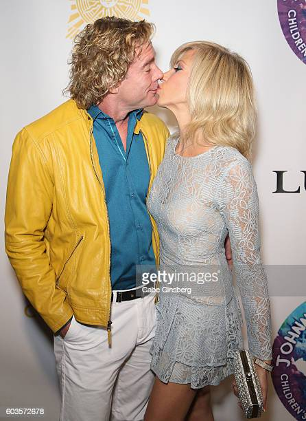 Dr Rutledge Taylor kisses singer/songwriter Debbie Gibson during Criss Angel's HELP charity event at the Luxor Hotel and Casino benefiting pediatric...