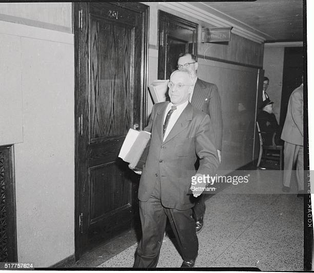 Dr S R Gerber coroner hurries into the courtroom of the Dr Samuel Sheppard murder trial after being recalled to the witness stand by Chief Defense...