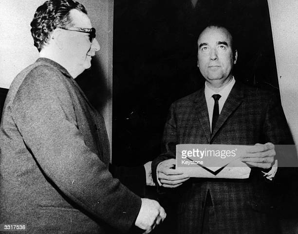 Dr Salvador Allende the first Marxist President for Chile receiving the voting decision from Benjamin Prade from the Partide Democratic Christians He...