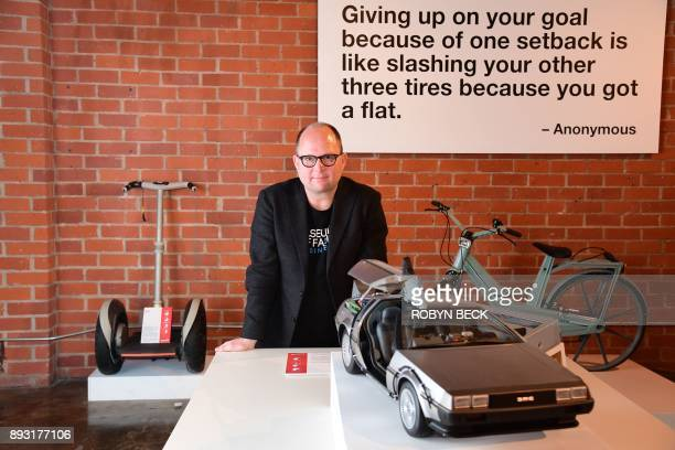 Dr Samuel West the curator of The Museum of Failure poses among some of the museum's displays including a plastic bicycle a DeLorean car and a Segway...