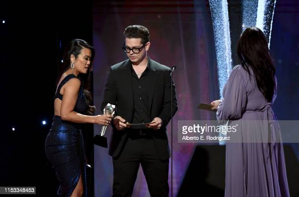Dr Sandra Lee aka Dr Pimple Popper accepts Female Star of the Year award from Jack Osbourne and Katrina Weidman onstage during the Critics' Choice...
