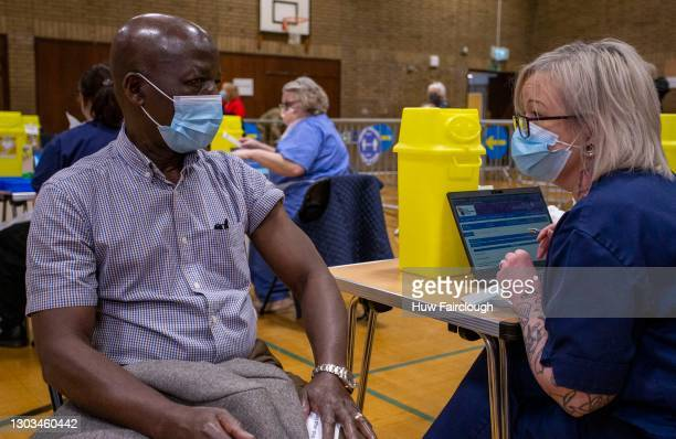 Dr Sele Mousa, a GP in Ebbw Vale receives his second dose of Covid-19 vaccine on February 22, 2021 in Newbridge, Wales. Dr Mousa openly promotes the...