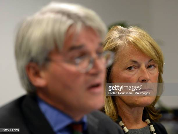 Dr Sharon Bennett watches her husband Andrew Mitchell speak, during a press conference in London, as he gives his reaction to the Crown Prosecution...