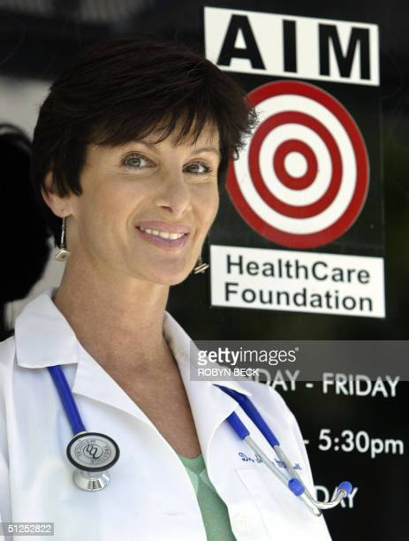 Dr. Sharon Mitchell poses for a photo at the entrance to the Adult Industry Medical Health Care Foundation clinic, 19 August 2004 in Sherman Oaks,...