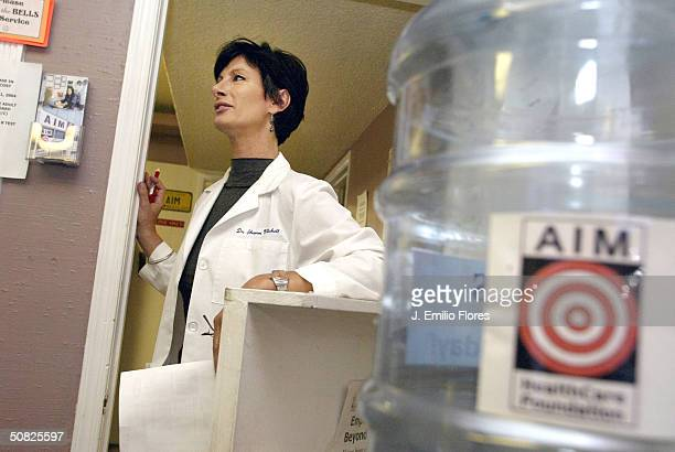 Dr. Sharon Mitchell speaks to a patient at the Adult Industry Medical Health Care Foundation clinic May 7, 2004 in Sherman Oaks, California. Mitchell...