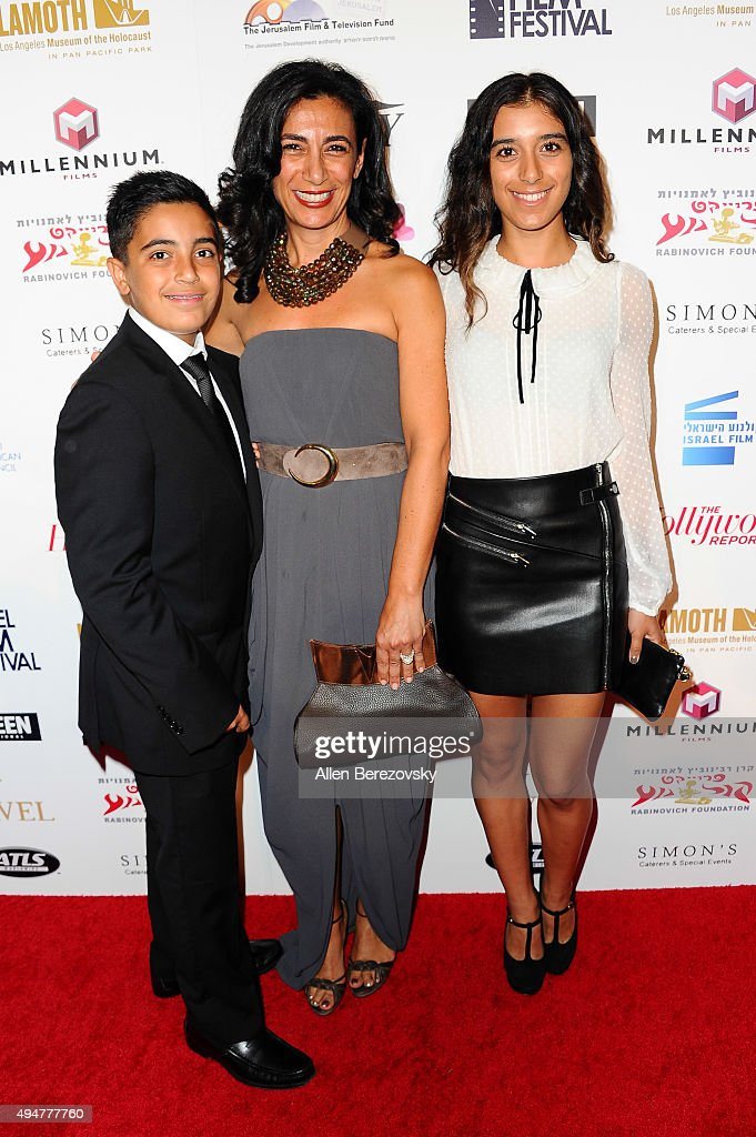 Dr. Sharon S. Nazarian (C) and children Adam (L) and Leila (R) arrive at the 29th Israel Film Festival's Opening Night Gala at Saban Theatre on October 28, 2015 in Beverly Hills, California.