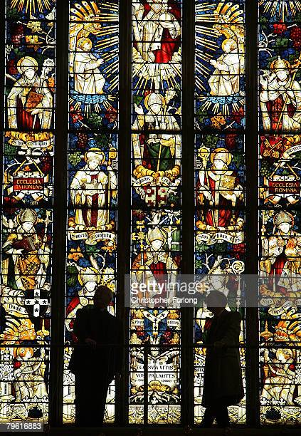 Dr Simon Thurley Chief Executive of English Heritage and The Very Revd Adrian Dorber, Dean of Lichfield Cathedral, view one of the stained glass...