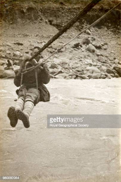 Dr Somervell crossing the rope bridge at Kharkung China 20 March 1922 Mount Everest Expedition 1922
