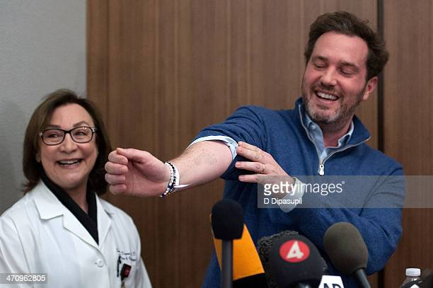 Dr. Sona Degann looks on as Christopher O'Neill, husband of H.R.H. Princess Madeleine of Sweden, shows a footprint on his arm from his newborn...