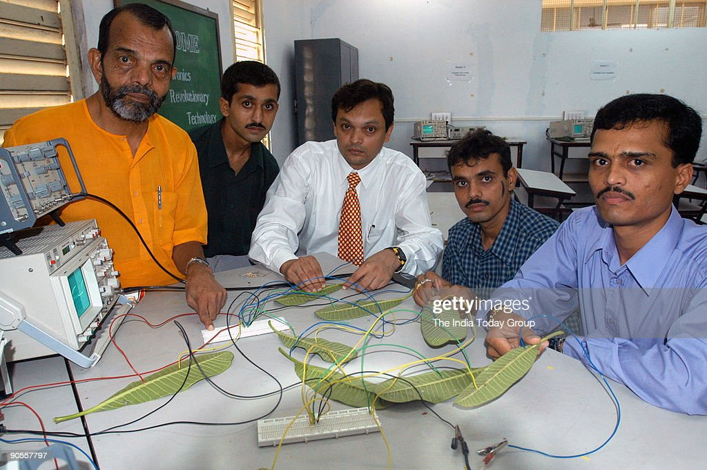 Dr SP Kosta (yellow) and Dr YP Kosta (white) with other Key circuit Scientest at Revolutionary Biomass Electronic Concept and Technology in Changa science college, Gujarat, India : News Photo