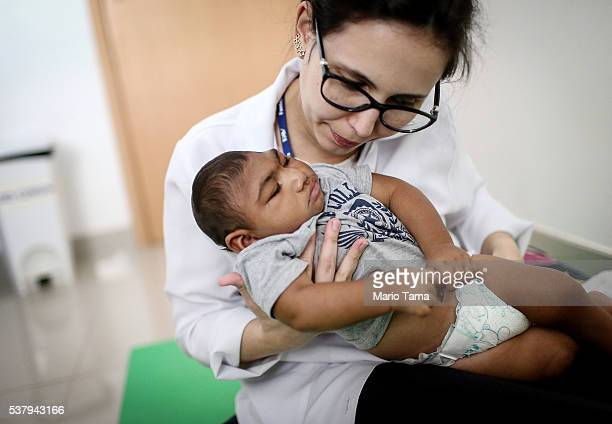 Dr. Stella Guerra performs physical therapy on an infant born with microcephaly at Altino Ventura Foundation on June 2, 2016 in Recife, Brazil....