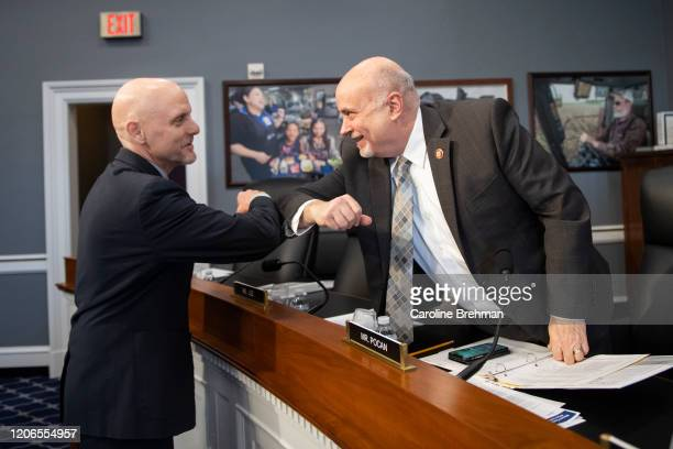 Dr Stephen M Hahn FDA Administrator left elbow bumps Rep Mark Pocan DWisc before the start of a House Appropriations Subcommittee hearing on...