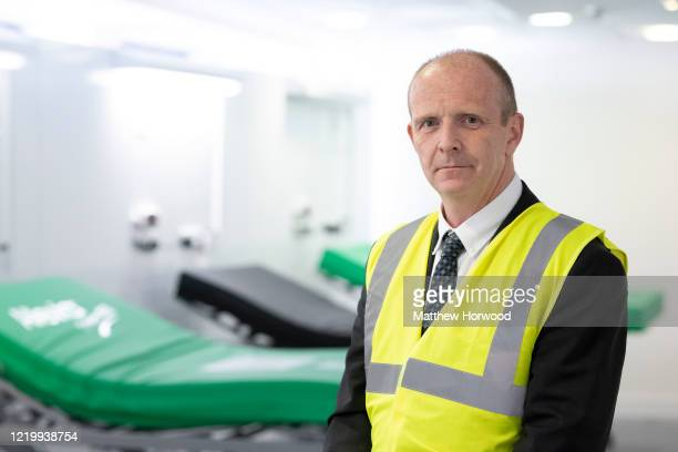 Dr Stuart Walker, Executive Medical Director for the Cardiff and Vale Health Board, poses for a photograph on a ward at the new Dragon's Heart...