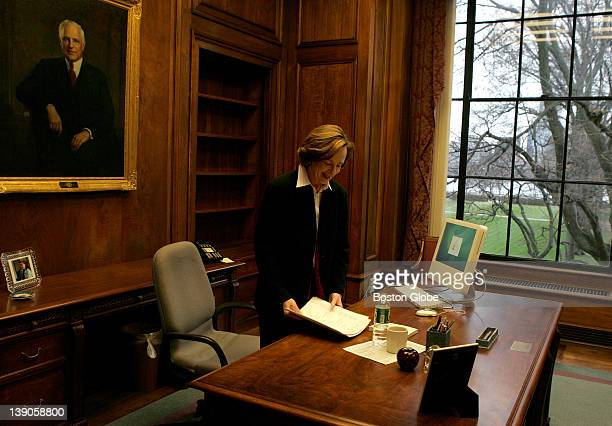 Dr Susan Hockfield MIT's new president during her first day on the job Here she arranges her desk under the painting of former president Carl Compton