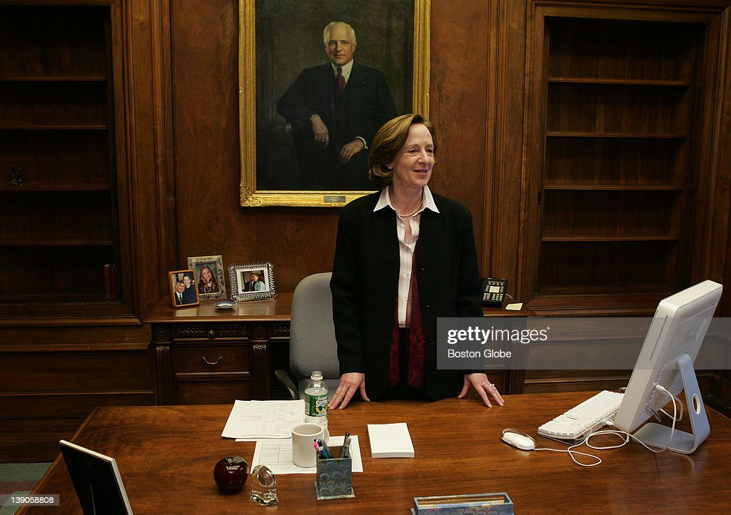 Dr. Susan Hockfield, MIT's new president, during her first day on the job. Behind her desk is a painting of former president Carl Compton (1930 - 1939).