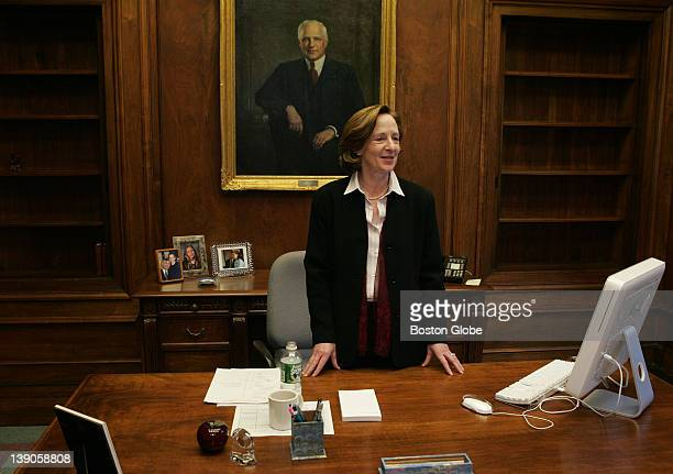 Dr. Susan Hockfield, MIT's new president, during her first day on the job. Behind her desk is a painting of former president Carl Compton .