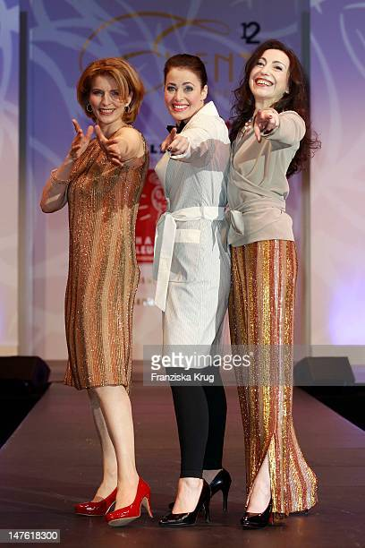 Dr Susanne Holst and Annika de Buhr and Isabella VertesSchuetter show designs on the catwalk during the charity event 'Event Prominent' at the Hotel...