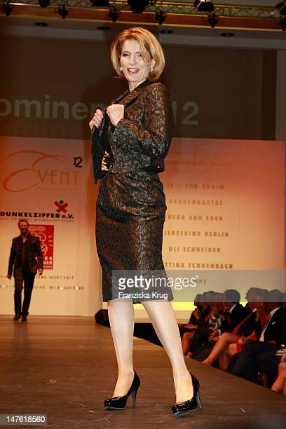 Dr Susanne Holst shows designs on the catwalk during the charity event 'Event Prominent' at the Hotel Grand Elysee on March 25 2012 in Hamburg Germany