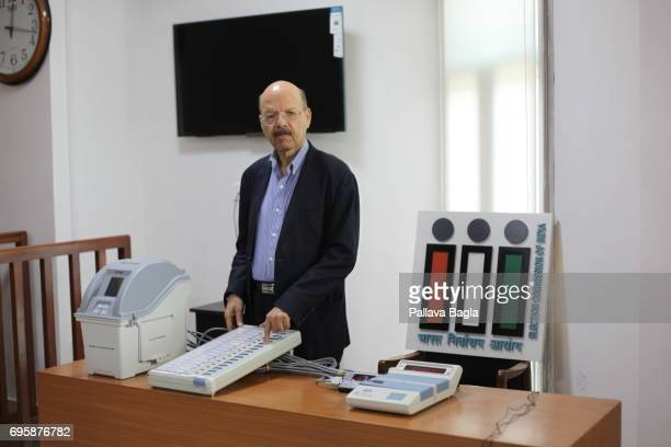 Dr Syed Nasim Ahmad Zaidi India's Chief Election Commissioner and the guardian of Indian democratic process demonstrating the use of an electronic...