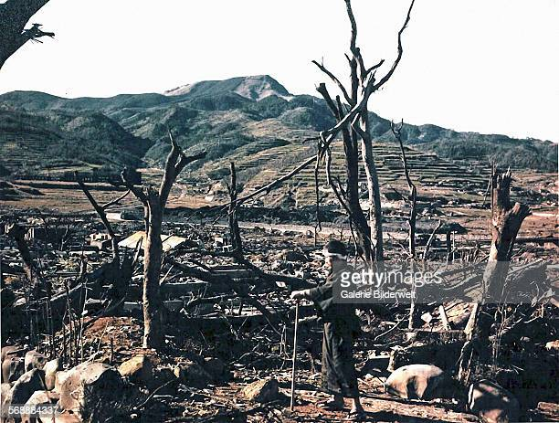 Dr Takashi Nagai of Nagasaki Hospital inspecting damage caused by the atomic bomb in the Matsuyama District August 1945 The ruins of the Nagasaki...