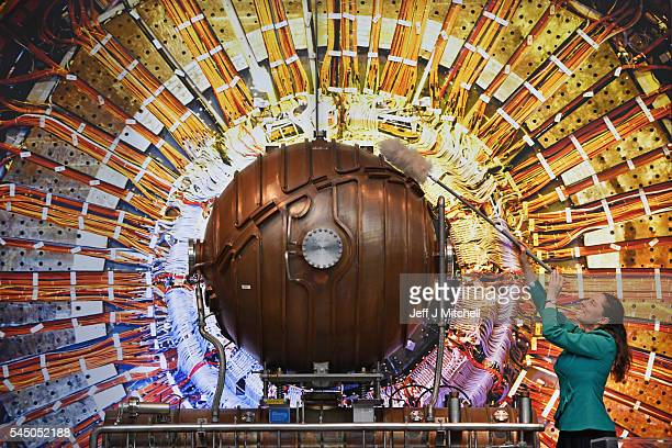Dr Tayce Phillips dusts the accelerating cavity from CERN's large electron positron collider during the opening of a major new development at the...