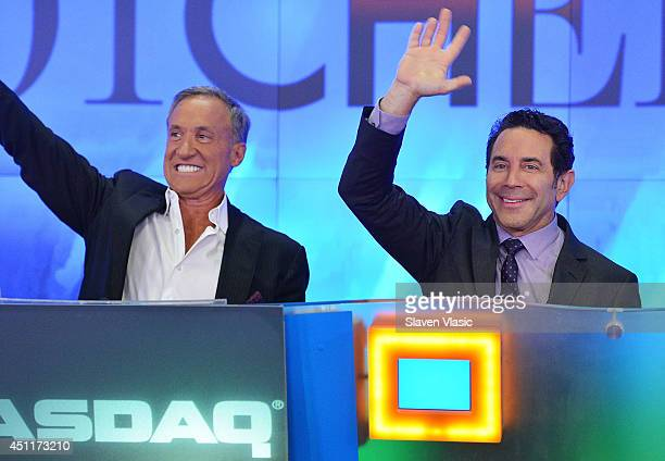 Dr Terry Dubrow and Dr Paul Nassif the cast members of 'Botched' ring the closing bell at NASDAQ MarketSite on June 24 2014 in New York City