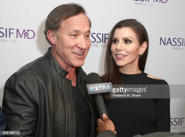 Dr Terry Dubrow Heather Dubrow arrive for Dr Paul Nassif unveils Dr Paul Nassif new medical spa with grand opening and ribbon cutting ceremony on...