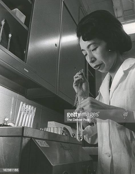 DR Dr Teruko Ishizaka conducts experiment to determine antibody activity in immunochemistry laboratory at CARIH Her husband heads department