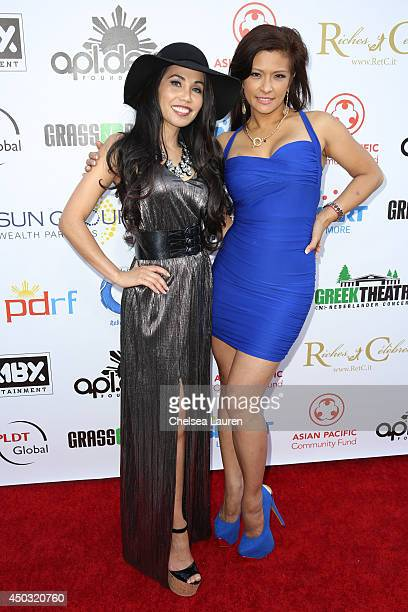 Dr Tess Mauricio and actress Anjanette Abayari arrive at the Rebuild benefit concert for Typhoon Haiyan survivors at The Greek Theatre on June 8 2014...