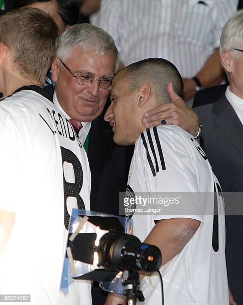 Dr. Theo Zwanziger hugs Timo Gebhart of Germany after the U19 European Championship final match between Germany and Italy on July 26, 2008 in...