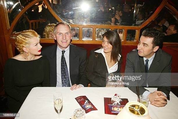 """Dr. Thomas Borer wife Shawne Fielding and and and politician Cem Özdemir Pia Castro In """"Pomp Duck And Circumstance"""" """"New Year's Reception"""""""