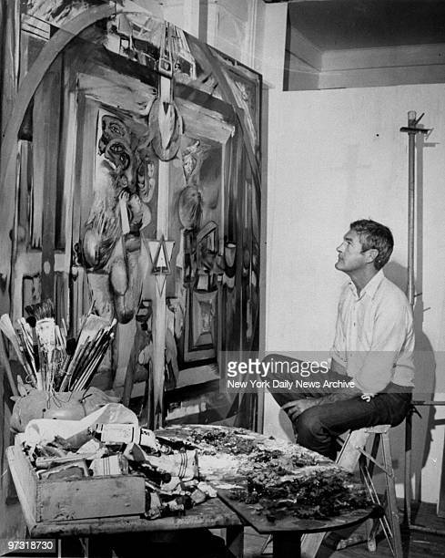 Dr Timothy Leary studies a painting done by another LSD user in a studio at a Millbrook NY house