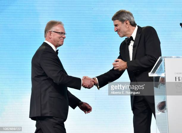 Dr Vaughn A Starnes and CHLA CEO Paul Viviano onstage at the 2018 Children's Hospital Los Angeles 'From Paris With Love' Gala at LA Live on October...