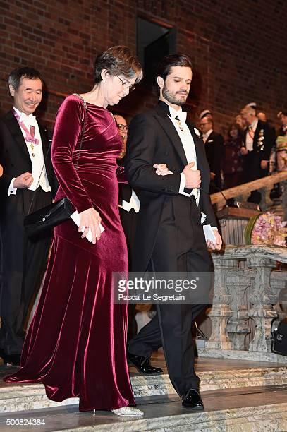 Dr Vickers Burdett and Prince Carl Philip of Sweden arrive at the Nobel Prize Banquet 2015 at City Hall on December 10 2015 in Stockholm Sweden
