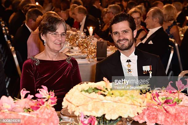 Dr Vickers Burdett and Prince Carl Philip of Sweden attend the Nobel Prize Banquet 2015 at City Hall on December 10 2015 in Stockholm Sweden