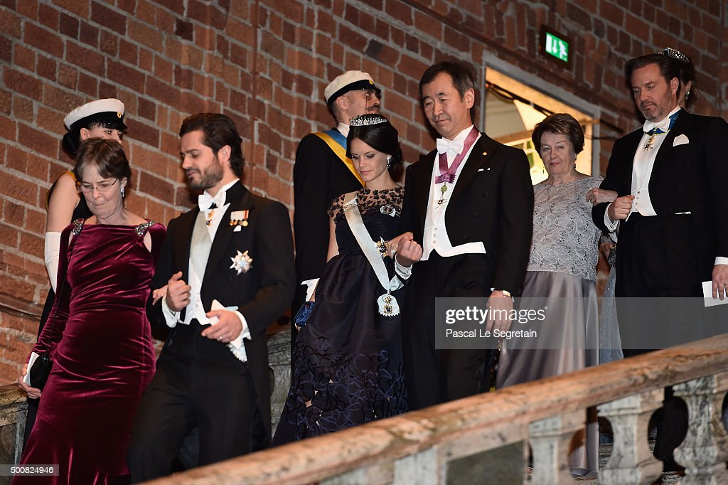 Dr Vickers Burdett and Prince Carl Philip of Sweden followed by Princess Sofia of Sweden and Nobel Prize in Physiology or Medicine, Professor Satoshi Omura arrive at the Nobel Prize Banquet 2015 at City Hall on December 10, 2015 in Stockholm, Sweden.