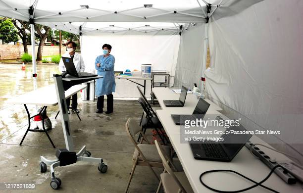 Dr Victor Sunga wait along with RN manager Ana Lastra during Coronavirus testing by the city of West Covina and AltaMed in West Covina on Tuesday...