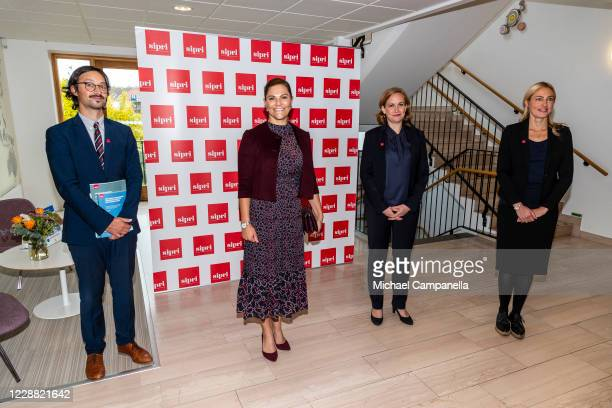 Dr Vincent Boulanin, Crown Princess Victoria of Sweden, Dr Tytti Erasto, and Dr Jannie Lilja pose for a picture during a visit to the Stockholm...