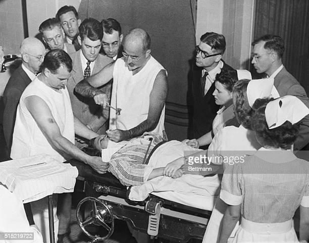 Dr Walter Freeman performs a lobotomy using an instrument like an ice pick which he invented for the procedure Inserting the instrument under the...