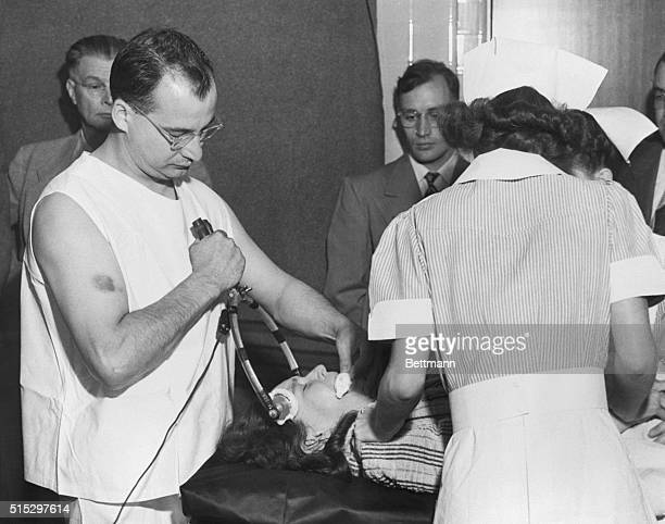 7/11/1949 Dr Walter Freeman Professor of Neurology at George Washington University demonstrates his new surgical technique in a refined operation...