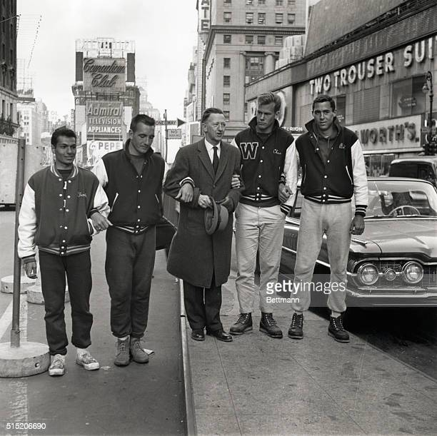 Dr Walter Hendricks president of Windham College in Putney Vermont stands between the four Windham students who arrived in Times Square after a...