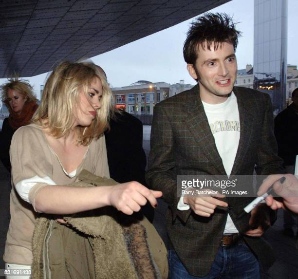 Dr Who stars David Tennant and Billie Piper sign autographs as they arrive for the media screening at the Millennium Centre in Cardiff Tuesday March...