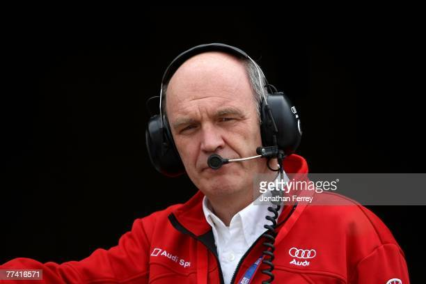 Dr Wolfgang Ullrich head of Audi Sport watches practice for the American Le Mans Series Monterey Sports Car Championships at Laguna Seca Raceway on...
