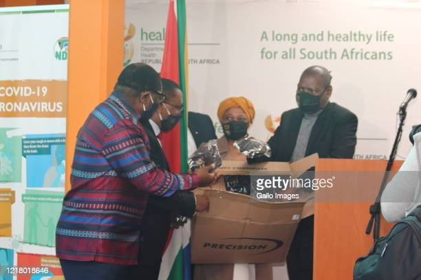 Dr. Zwelini Mkhize , David Makhura and Dr. Bandile Masuku hands over ventilator machines donated by the United States of America Government to Chris...