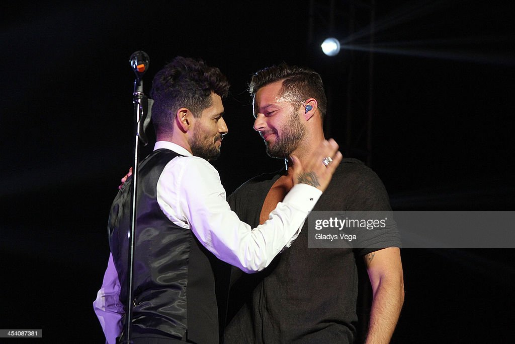 Draco Rosa performs with Ricky Martin at Draco & Friends Concert at Coliseo de Puerto Rico on December 6, 2013 in San Juan, Puerto Rico.