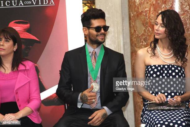 Draco Rosa sits with Angela Alvarado as he is honored by Puerto Rico House of Representatives on December 10 2013 in San Juan Puerto Rico